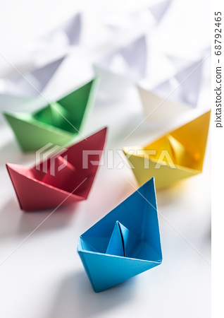 Multi colored paper boats. Concept of leadership 68792465