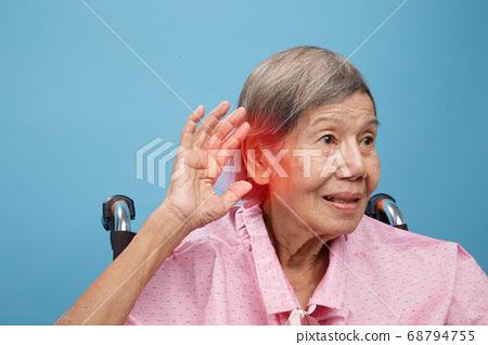 Senior adult woman hearing loss , Hard of hearing 68794755