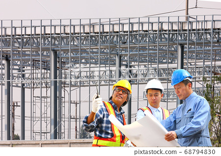 group of engineer in uniform are brainstorming to run the project finish in time 68794830