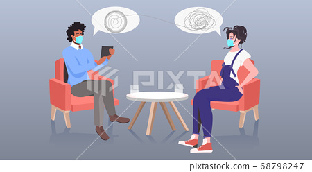 psychotherapist in mask consulting patient during psychotherapy session coronavirus pandemic protection 68798247