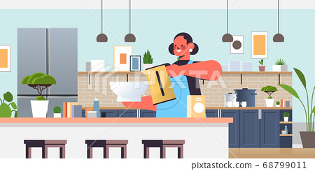 happy woman preparing food cooking at home concept modern kitchen interior 68799011