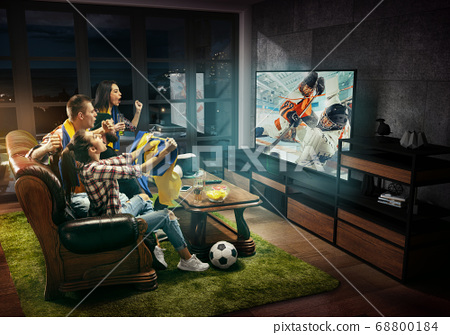Group of friends watching hockey match, sport together 68800184