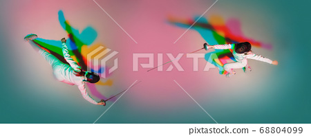 Teen girl in fencing costume with sword in hand on gradient background with neon light, top view 68804099