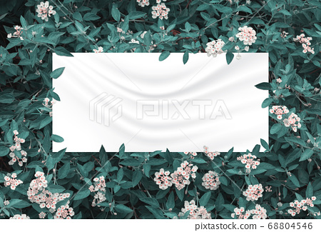 green leaves and flowers above crumpled fabric 68804546