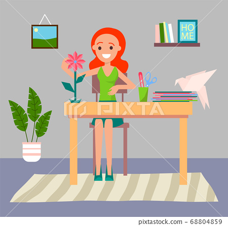 Girl making origami or paper figure of flower, stay at home during quarantine isolation, new hobby 68804859