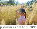 girl with the energetic style in the field 68807895