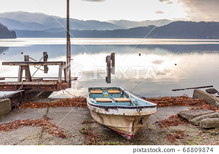 Boat landing stage dock in early morning, with view of Lake Suigetsu and mountains, Fukui Prefecture, Japan. 68809874
