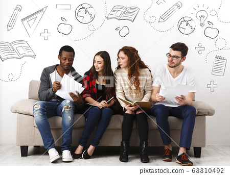 Diverse young students preparing for exam together 68810492