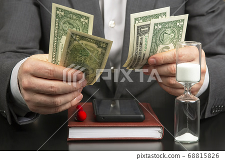 business man in the office counts money on a 68815826