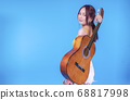 Happiness young woman with an acoustic guitar 68817998