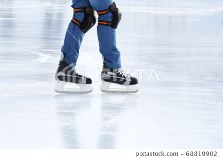 feet rolling on skates man on the ice rink 68819902