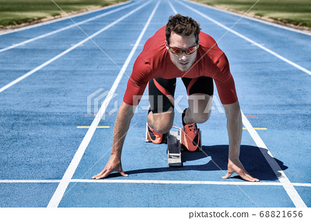 On your mark, get set, go! Running sport concept athlete ready for run competition at starting line. Sprinter man on running tracks. 68821656