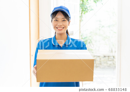 Courier female driver delivering luggage 68833148