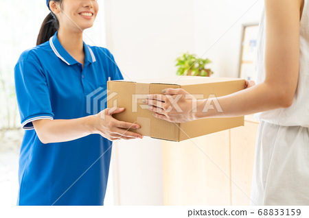 Courier female driver delivering luggage 68833159
