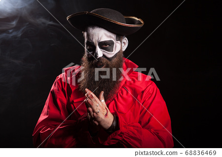 Man dressed up like a spooky medieval pirate 68836469