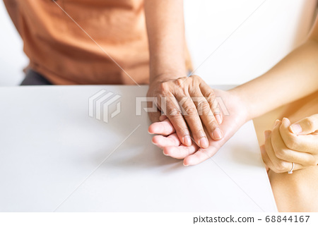 Woman holding hands to elderly with alzheimer disease at home,Adult social care concept 68844167