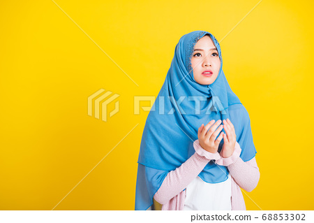 Woman wearing hijab she henna decorated hands 68853302