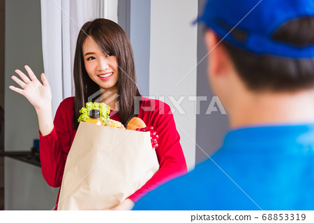 Delivery man making grocery service giving fresh 68853319