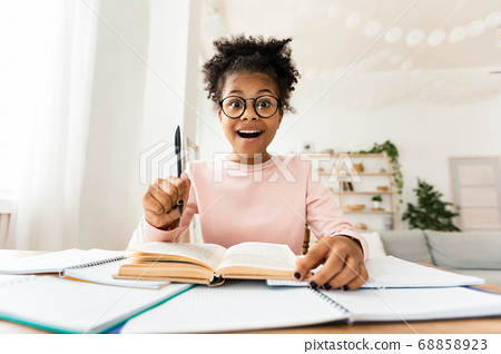 Excited Teen Girl Having Eureka Moment Doing Homework At Home 68858923