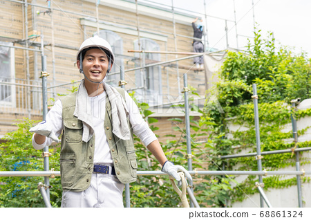 Young male worker working at a construction site 68861324