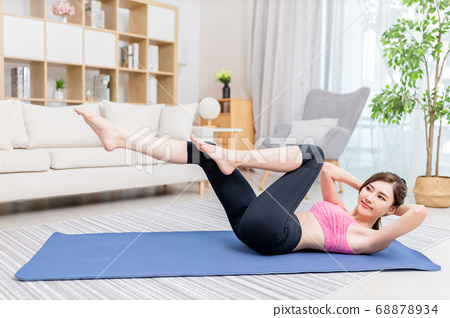 woman doing exercise at home 68878934