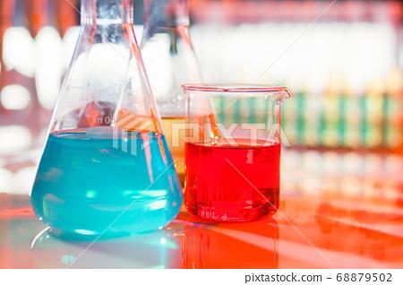 Backlit laboratory flask. 68879502