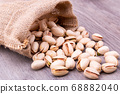 Pistachios nut in burlap sack on grained wood 68882040