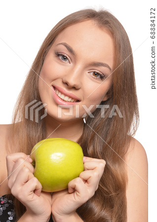 Close up portrait of beautiful young woman with green apple 68884172