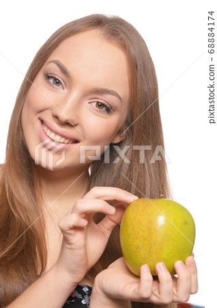 Close up portrait of beautiful young woman with green apple 68884174