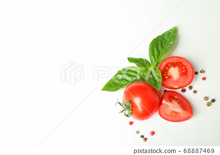 Fresh cherry tomatoes with basil and spices on 68887469