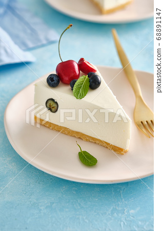 No baked cheesecake with fresh blueberry on white background, selective focus. 68891147