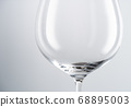 Empty clean wineglass on white background 68895003