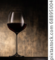 Glass of red wine on table 68895004