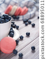 Fresh blueberries and macaroon on table 68895011
