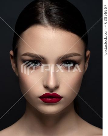 Young beautiful woman with evening makeup 68896967