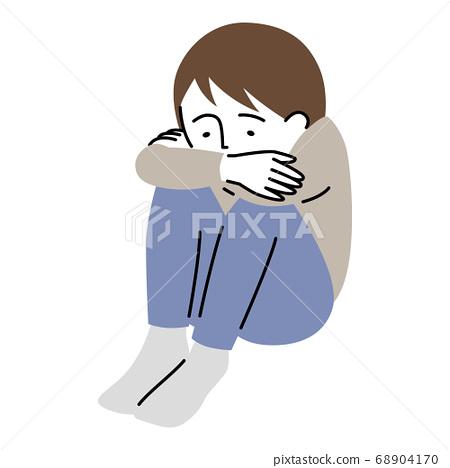 一个男孩sit缩着沮丧的表情坐着 68904170
