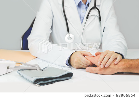 Female doctor holding patients hand. Medicine 68906954
