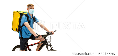 Deliveryman isolated on white studio background. Contacless delivery service during quarantine. 68914493