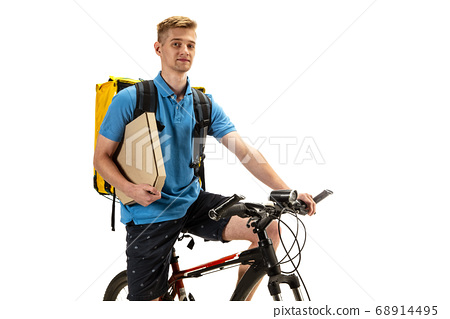 Deliveryman isolated on white studio background. Contacless delivery service during quarantine. 68914495