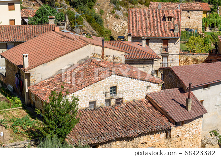 Background of old village houses with stone walls and red tile roofs 68923382