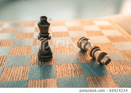 Chess game winning concept. Victory move with last piece standing on chessboard wooden board 68924234