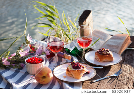 picnic on a wooden pier 68926937