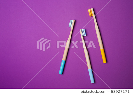 bright toothbrushes on a Violet background 68927171