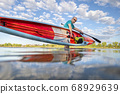 solo senior male stand up paddler 68929639