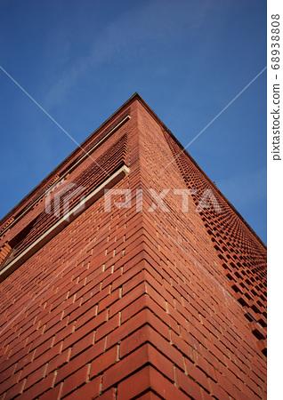 Building corner. Corner of red brick building on blue sky background 68938808