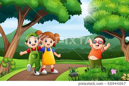 Three of kids having fun along the road 68944867