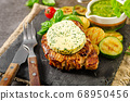 Delicious pork steak with herb butter 68950456