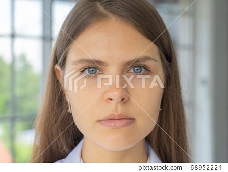 Close-up of pretty western woman face skin. Female 68952224