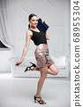 Attractive lady dressed in a shirt and skirt 68955304