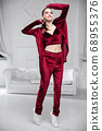 Sexy brunette dressed in a burgundy velor suit 68955376